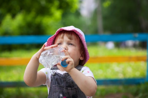 child drinking from the bottle