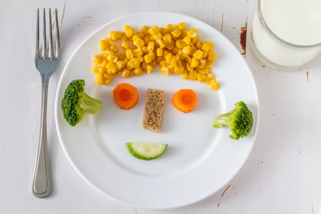 fruits and vegetables arranged attractively on the plate